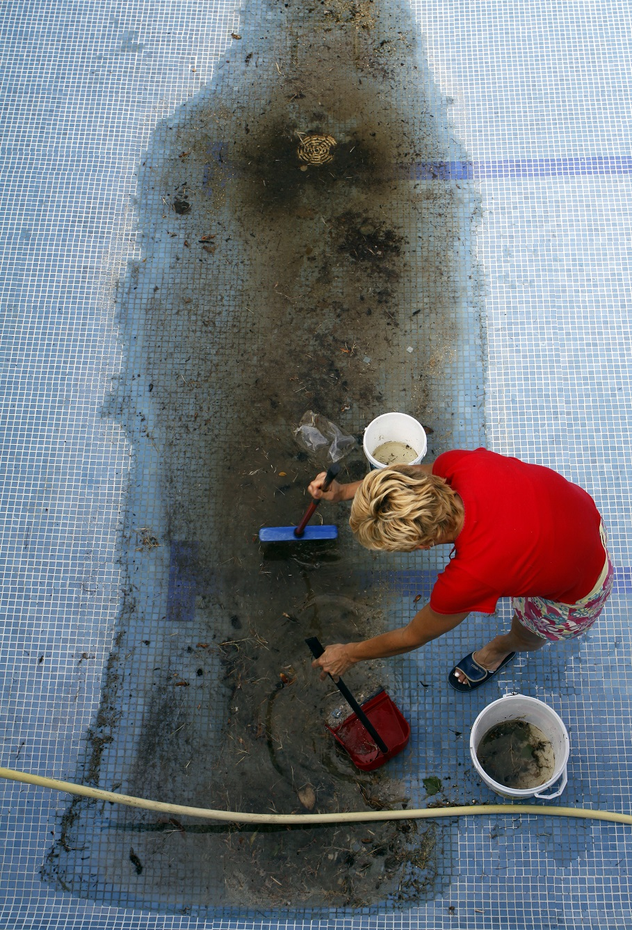 Woman Cleaning The Swimming Pool Eagle Pools Eagle Pools